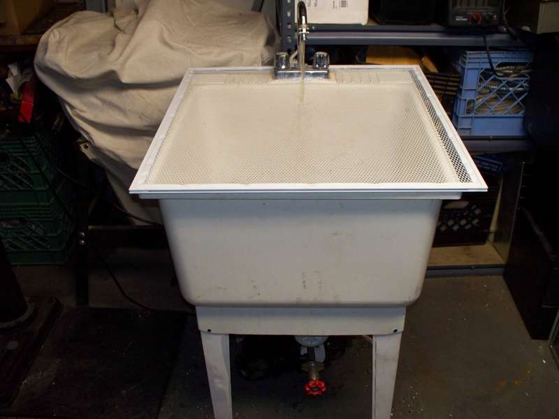 utility_tub_with_a_drain_valve_and_a_water_filter_.jpg