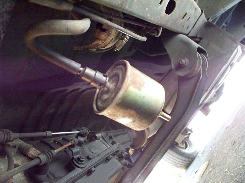 The old fuel filter is being disconnected.   Ford Explorer - Ford Ranger  Forums - Serious ExplorationsSerious Explorations
