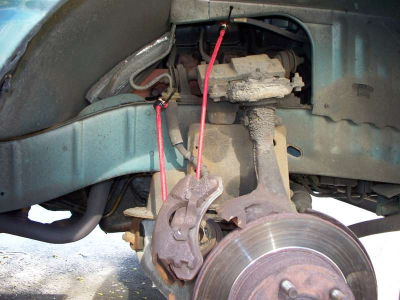 A_bungee_stretch_cord_is_holding_the_caliper_.JPG